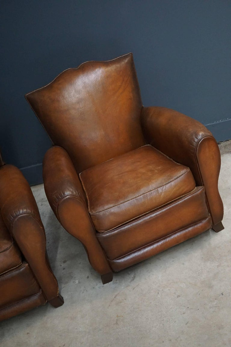 Industrial Pair of French Cognac Moustache Back Leather Club Chairs, 1940s For Sale