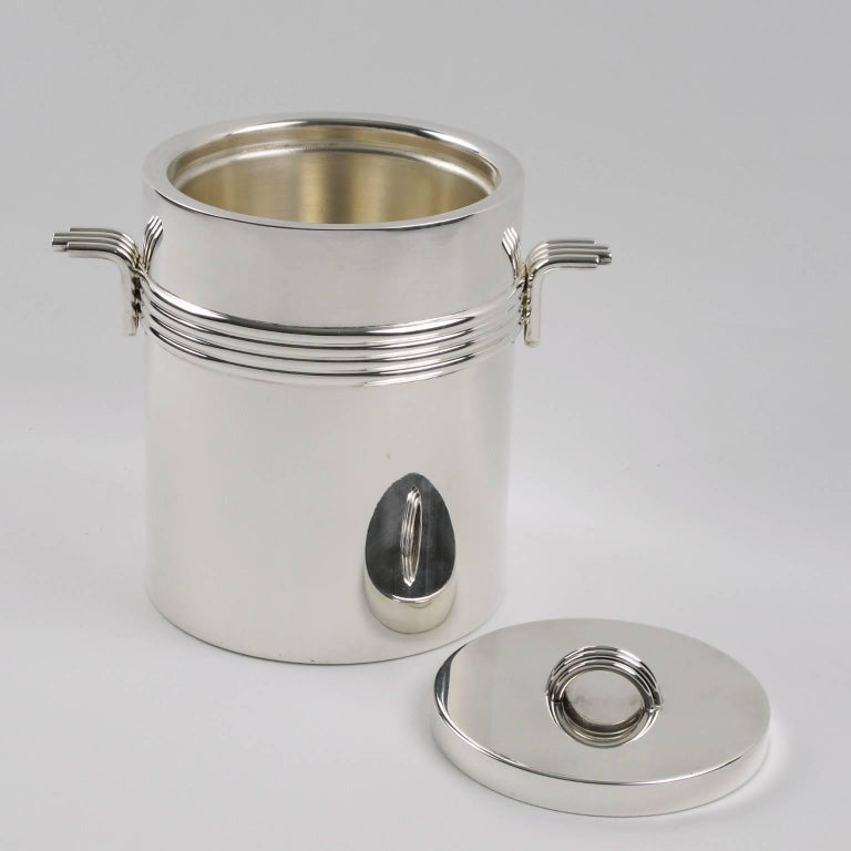 Elegant Christian Dior, Paris Mid-Century Modernist lidded ice bucket. This silver plate sophisticated ice bucket features iconic streamline design with concentric rings and clean lines. Manufactured in France, circa 1970s. Marked underside: