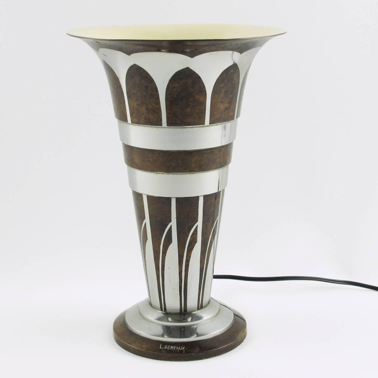 Rare stylish elegant French Art Deco dinanderie uplight table lamp by Lucien Gerfaux, circa 1930s. The metal ware (either brass or copper) has a mottled brown patina with inlaid silver metal in geometric patterns. Typical geometric Art Deco design.