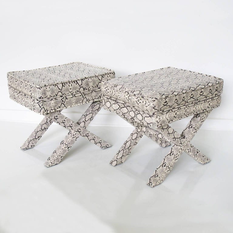 Elegant pair of benches, ottomans, footstools in faux python skin in the manner of Billy Baldwin. Sleek and urbane design with Classic