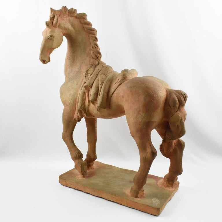 Elegant fine French 1940s terracotta sculpture by J. de Monpesat (France, 20th century). Superb animal sculpture, original patina and stylish designed horse, hand-signed incised J. DE MONPESAT signature on plinth base. Spectacular surface finish