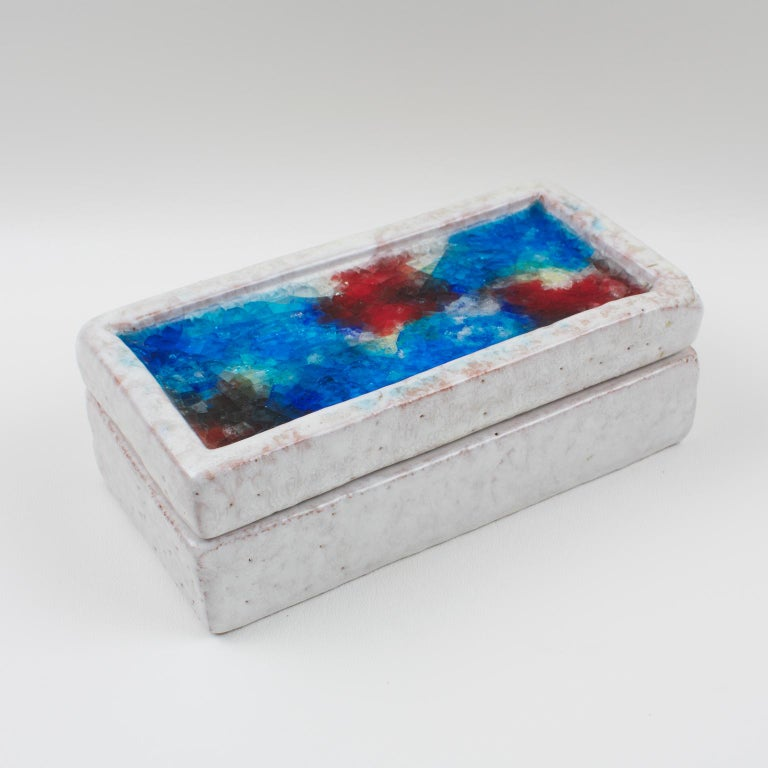 Stunning 1960s Aldo Londi for Bitossi ceramic lidded box. Imported and distributed in the United States by Raymor of New York. Featuring a rectangular box with lid with off-white glaze and multicolored abstract design on lid in fused glass also
