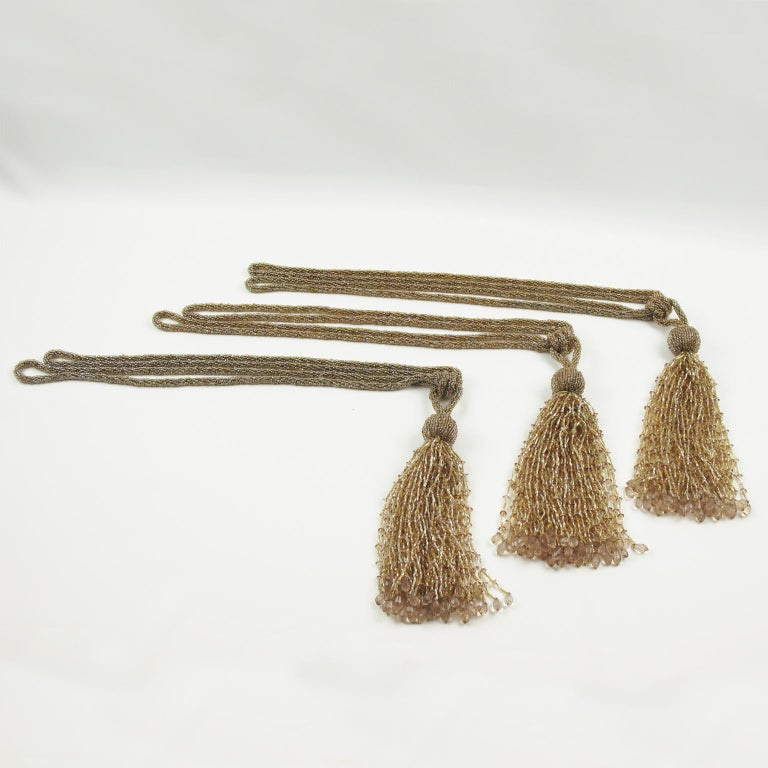 Stunning set of three French Art Deco curtain tassels tie backs or retainers. All made with crystal beads, faceted and carved in assorted colors of gold, champagne and light powder pink. Beautiful quality for any precious room in your home.