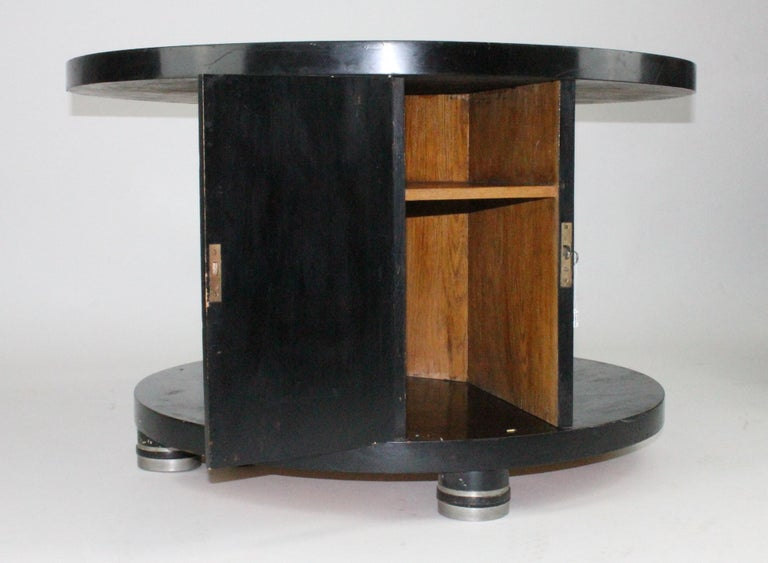 Amazing table and so rare, by Alvar Andersson for Hyresgästernas Möbelförening 1933. Black painted wood with pewter inlays. This table is unrestored! Wheels underneath, see images. One door with one shelve.
