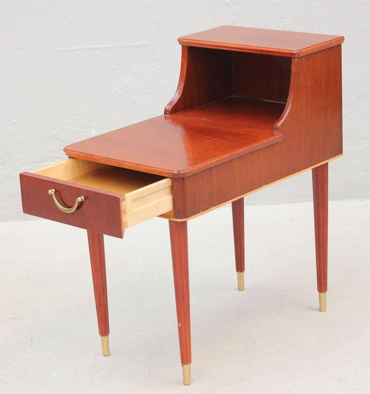 Pair of nightstands in mahogany, circa 1955. Designed by David Rosen for Nordiska Kompaniet. Handles and feet in brass.  We are shipping worldwide, please contact us for the best shipping price.