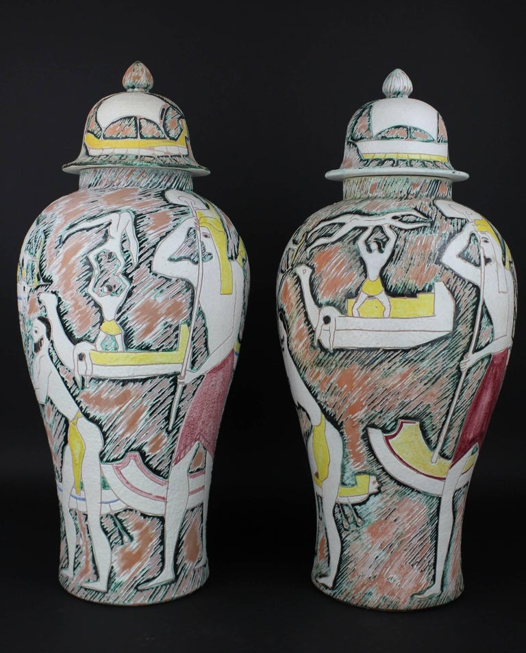An outstanding pair of vases with covers in the sgraffiti technique by the Italian master Marcello Fantoni. These ceramic masterpieces are in perfect condition and they are both signed. These are made in the Italian Etruscan style. Marcello has used
