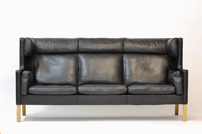 The combination of simple clean lines and expert craftsmanship are the trademarks of Børge Mogensen. The coupé sofa is among his best work. The sofa was designed in the 1960s, marked with original sticker from manufacturer.