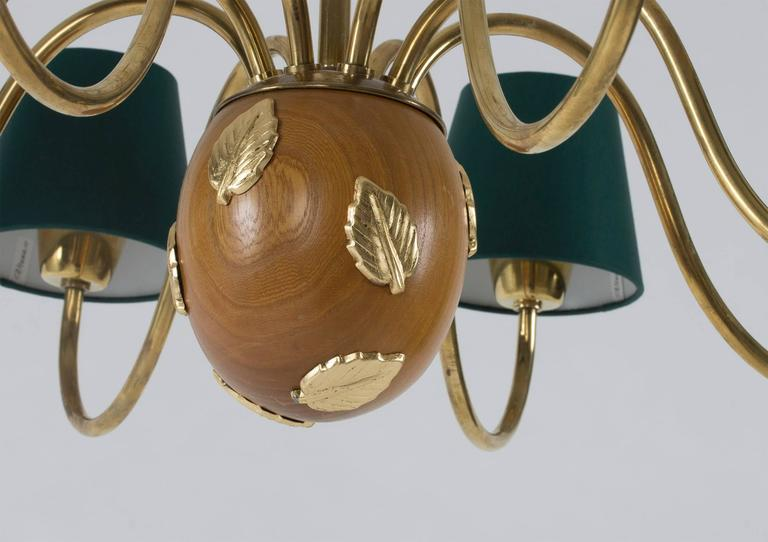 Brass and Mahogany Chandelier by Hans Bergström In Excellent Condition For Sale In Stockholm, SE