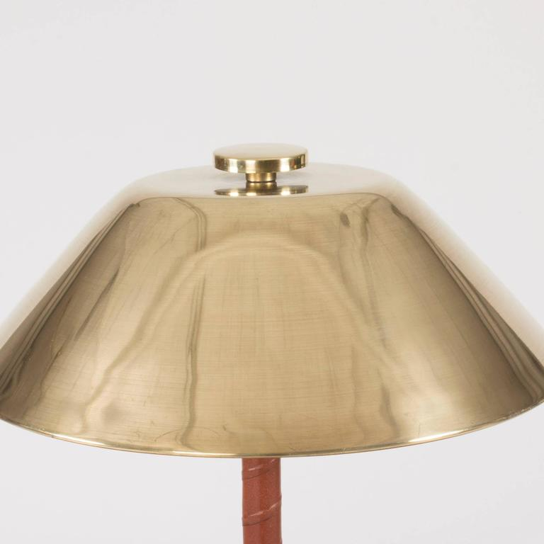 Brass and mahogany table lamp by Hans Bergström for ASEA. Luxurious design with a striped pattern in the handle and small slits around the edge of the lampshade.