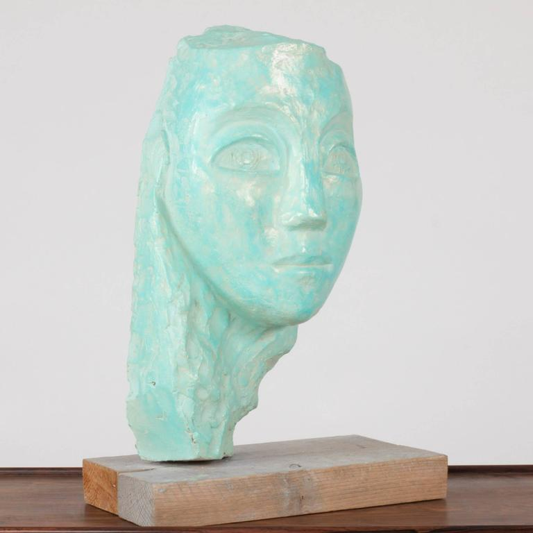 Soulful earthenware sculpture of a face by Lennart Olausson. Glazed turquoise with a slight shimmer.  Lennart Olausson (born 1944) is a Swedish artist, educated at Konstfack 1961-1965 and Kungliga Konsthögskolan (Royal Swedish Art Academy)
