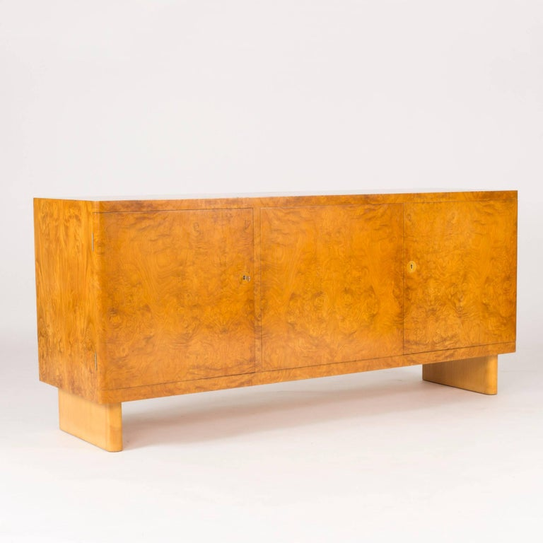 "Stunning alder root sideboard by Axel Einar Hjort, model named ""Birka"". Exceptionally cool, elegant and timeless design where a lightness has been achieved, notwithstanding the solid base. Beautiful root veneer in very good condition, with some"