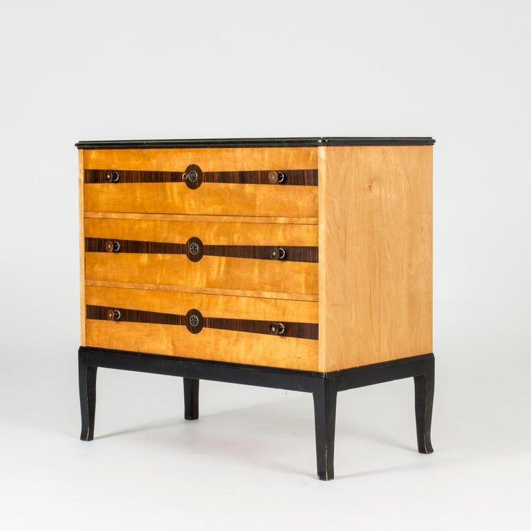 Beautiful chest of drawers by Erik Chambert. Made with birch on the drawer fronts, with zebrano inlays. Round drawer handles also with zebrano veneer. Slightly curved legs, painted black.