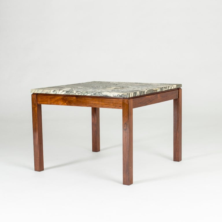 Neat Danish 1960s marble coffee table. Rosewood base and square marble table-top with a striking pattern.