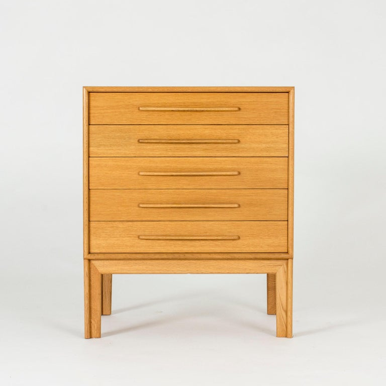 Neat oak chest of drawers with cool sculpted handles by Alf Svensson.