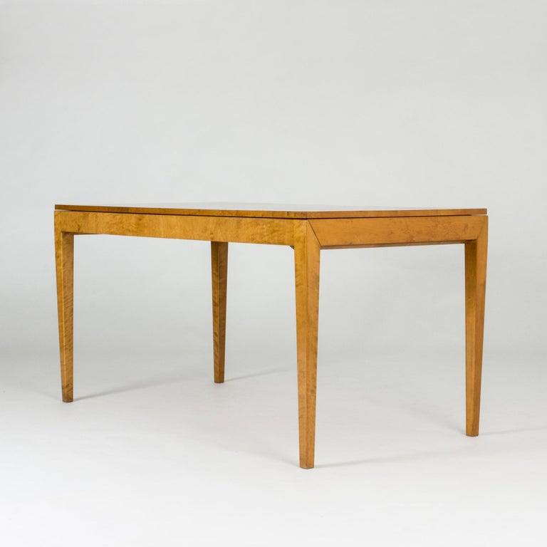 Striking functionalist dining table by Axel Larsson with diagonal joinery at the top of the legs. The table is made from beech with two extension leaves cleverly hidden under the tabletop. Beautiful life in the wood grain.