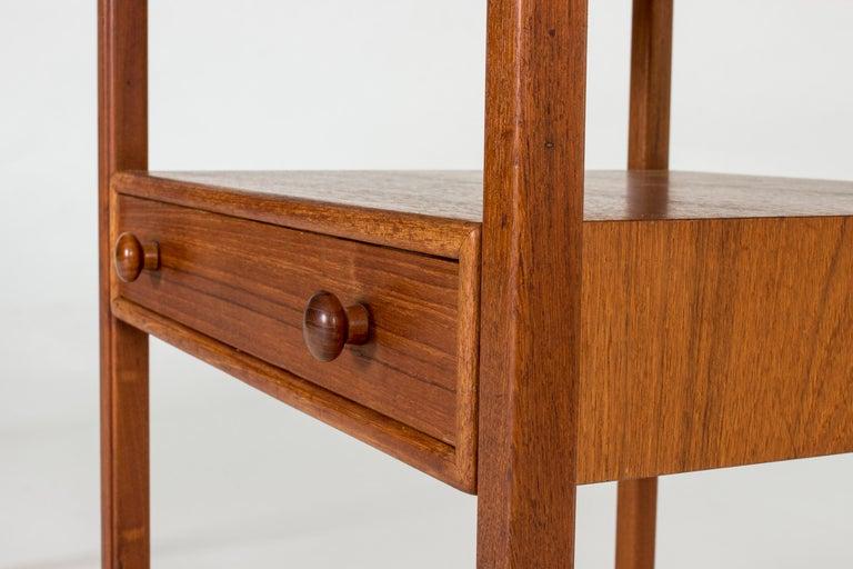 Mid-20th Century Pair of Midcentury Teak Bedside Tables by Sven Engström & Gunnar Myrstrand For Sale