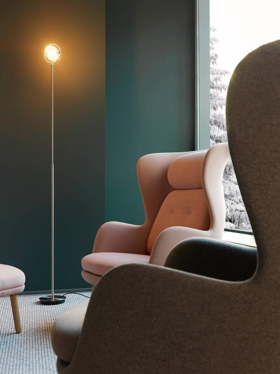 Designed by Metis Lighting in 1992 and manufactured by Fontana Arte, the Nobi floor lamp guarantees total practicality for innovative elegant design. The two bowl-shaped glass discs are held in position by a system of tiny springs and fastened to