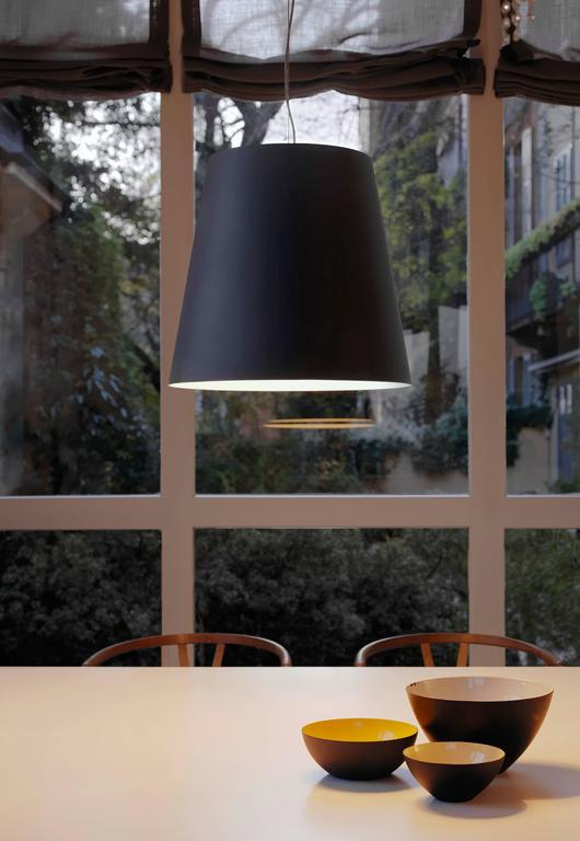 Designed in 2003 by Charles Williams for Fontana Arte, the Amax suspension lamp is an extra-large interpretation of the Classic FontanaArte lampshade. Amax is a family of suspension and floor lamps, available in both indoor and outdoor versions. For