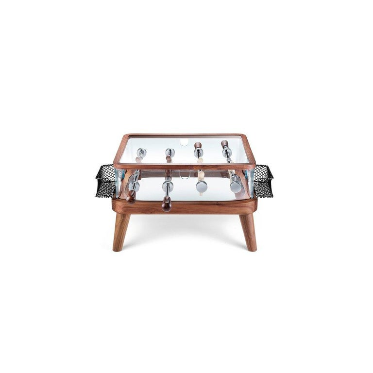 Intervallo foosball coffee table, designed by Adriano Design and manufactured by Teckell, features a solid milled Canaletto walnut structure. Players: one team Canaletto walnut, the other ash wood. Shell perimeter in 15 mm thick crystal. The