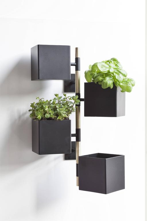 Pochette Is a multifunctional container that can hold small objects such as keys, glasses, phones. It can also be used as vertical garden to place vases and small plants. It is composed by revolving boxes around a vertical axis to be fixed to the