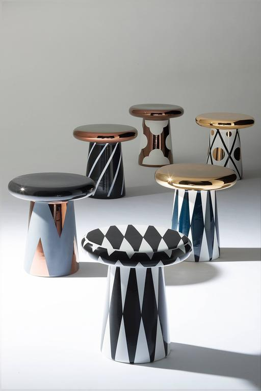 """T-Table special edition. Design Jaime Hayon.  Small ceramic table part of of a collection of six designs.  """"Functional, simple and organic, the T-Table is easy to hold and more around. Meant as an auxiliary small table to be placed near a"""