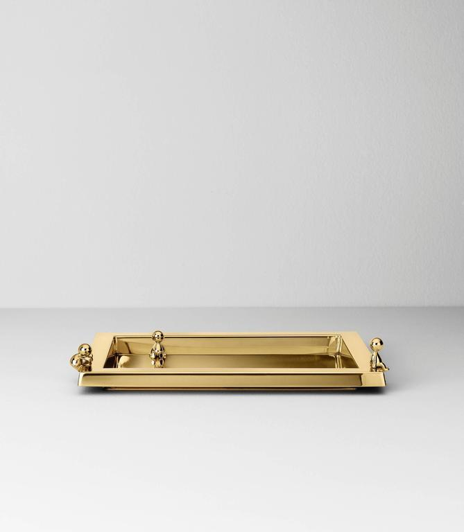 Serving tray in stainless steel finished in polished brass designed by Stefano Giovannoni.
