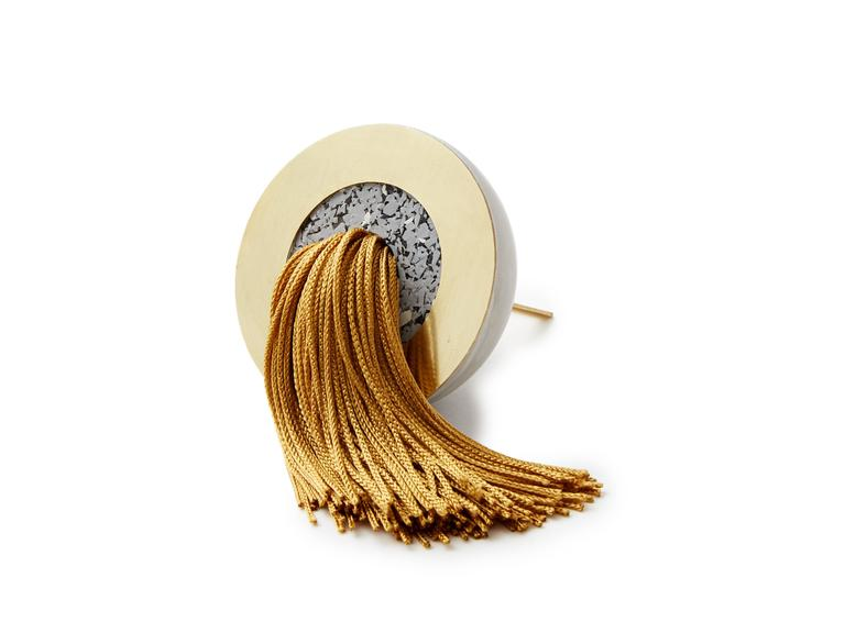One of a kind handmade tassels combining silk thread, brass, rubber and cast concrete as decorative objects.   Measures: 2