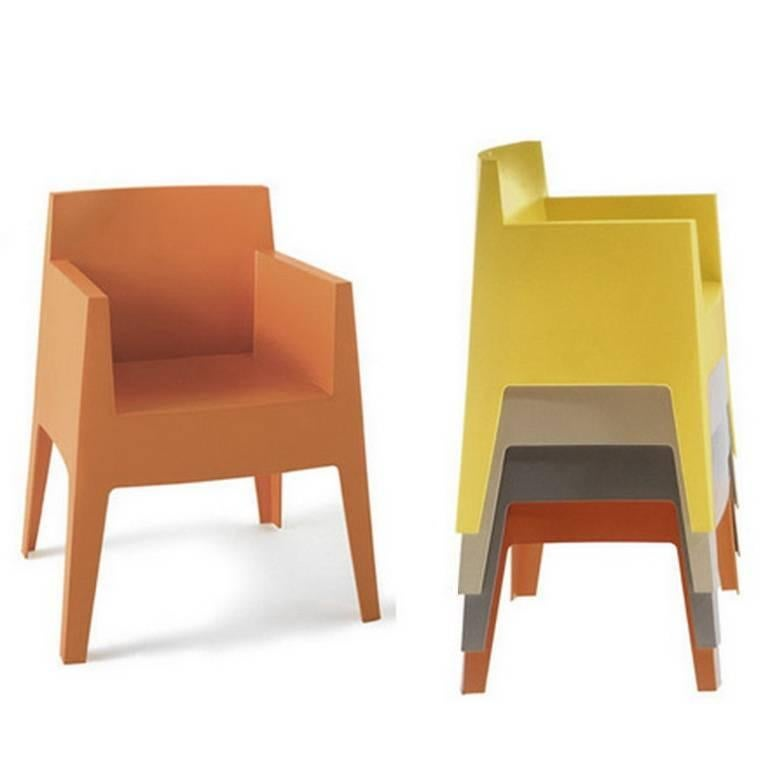toy mustard yellow or carnation stackable armchair by p starck for