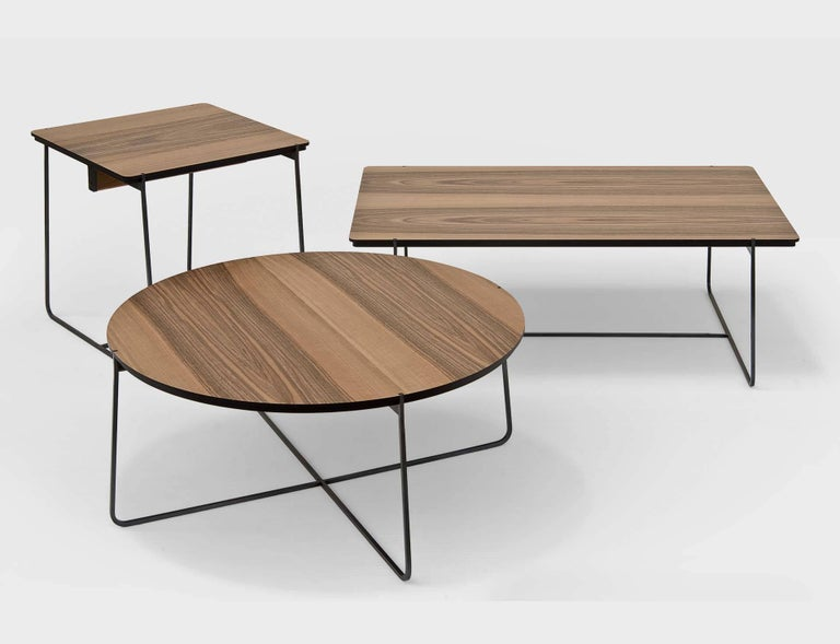 """""""Grand Cuvee"""" is a low rectangular side table, designed by Stephane Lebrun and manufactured by Dessie', featuring a top in black MD walnut veneered or covered by black leather and a metallic base structure made of square section steel with"""