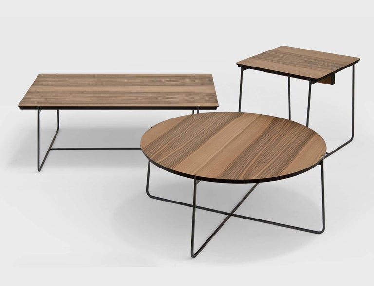 """""""Cuvee De Nuit"""" is a low rectangular side table, designed by Stephane Lebrun and manufactured by Dessie', featuring a top in black MD walnut veneered or covered by black leather and a metallic base structure made of square section steel"""