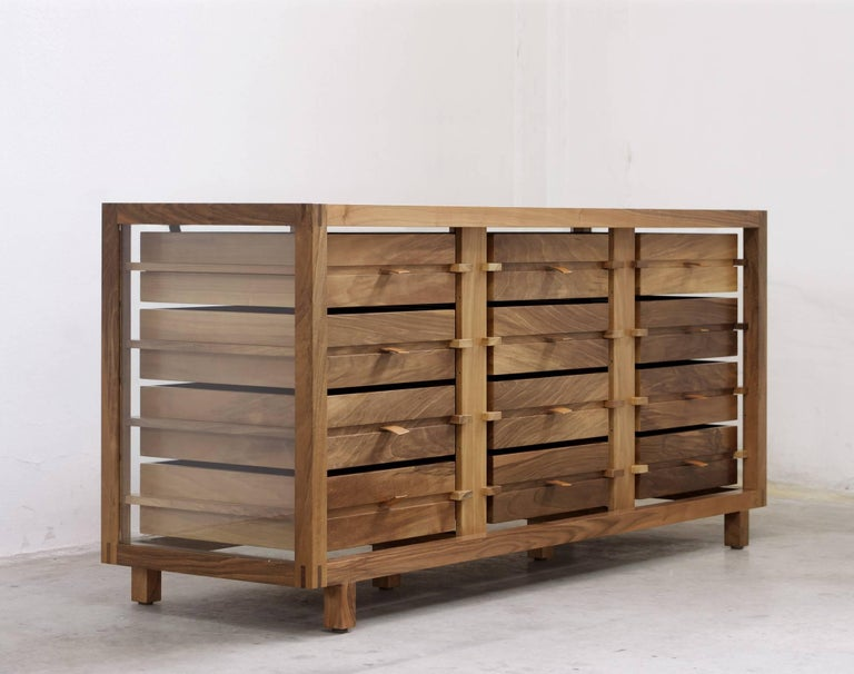 """""""Optimum"""", designed by Stephane Lebrun and manufactured by Dessie', has a structure made in solid Pascoso walnut (1.57"""" x 1.57"""") and features 8 or 12 drawers placed side by side onto two rows, handles made of full grain leather,"""