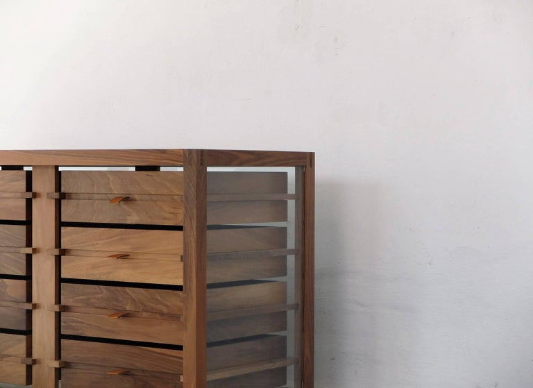"""""""Optimum"""", designed by Stephane Lebrun and manufactured by Dessie', has a structure made in solid Pascoso walnut (1.57"""" x 1.57"""") and features 10 drawers placed side by side onto two rows, handles made of full grain leather, top,"""
