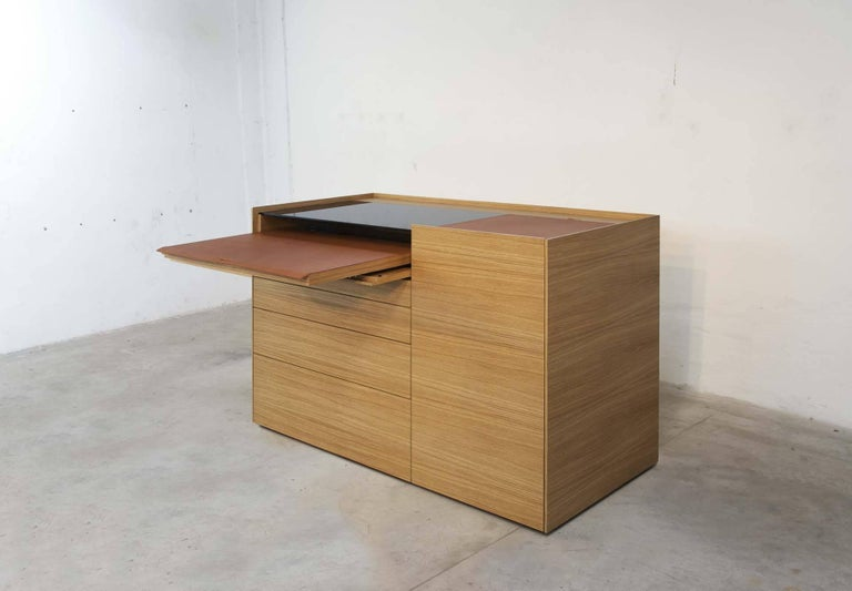 """Brown"" is a pc/laptop unit cabinet or desk, designed by Stephane Lebrun and manufactured by Dessie', with four drawers, one closed front compartment, two top compartments (for CPU and printer) with hinged covers, a sliding leather covered"