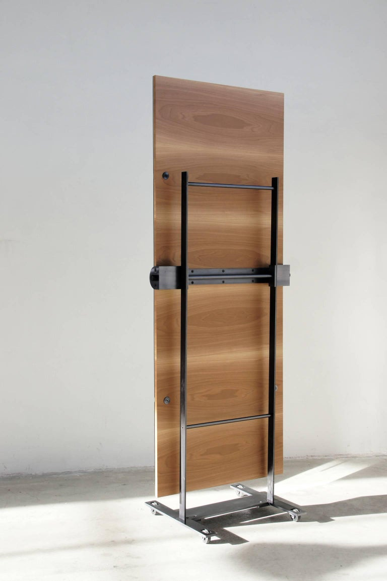 """""""Asas"""" is a self-standing castored floor mirror, designed by Jaume Tresserra and manufactured by Dessie', with adjustable tilt angle, featuring a natural walnut wood frame, solid walnut handles and metal fittings in antique nickel"""