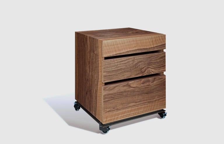 """""""Tecnica"""" is a drawers unit, designed by Jaume Tresserra and manufactured by Dessie', featuring three drawers in walnut, metallic base in antique nickel finish and castors with brakes. Indoor use only.  DIMENSIONS: D. 19.7"""", W."""