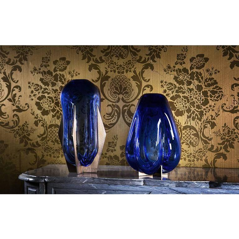 """Venturi Pear Blue"", designed by Lara Bohinc, is part of the Venturi collection and is available in ruby red, rose, sapphire and white filigrana glass, with the metal frames glazed in bronze. The process of handblown glass forms unique,"