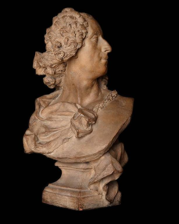 A 18th century terracotta bust of a man by the French sculptor Jean Baptiste Lemoyne, signed under the left side of the bust. The bust probably depicts the French painter, Lemoyne's friend, Noel-Nicolas Coypel.
