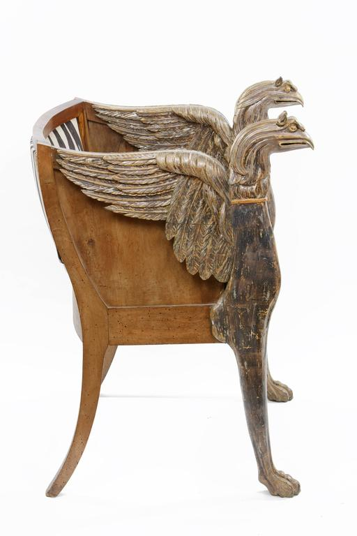Couple of Empire style armchairs with winged griffins on the armrest and zebra-skin cover Tuscany, early 19th century.