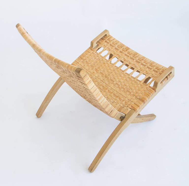 Danish Pair of Hans Wegner Oak and Cane Folding Lounge Chairs