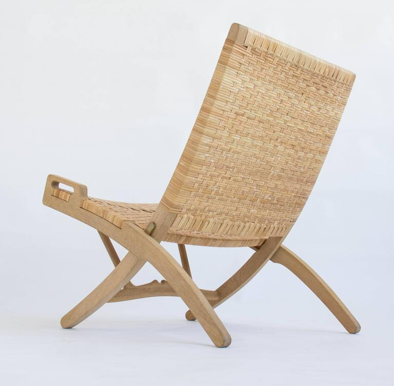 Woven Pair of Hans Wegner Oak and Cane Folding Lounge Chairs