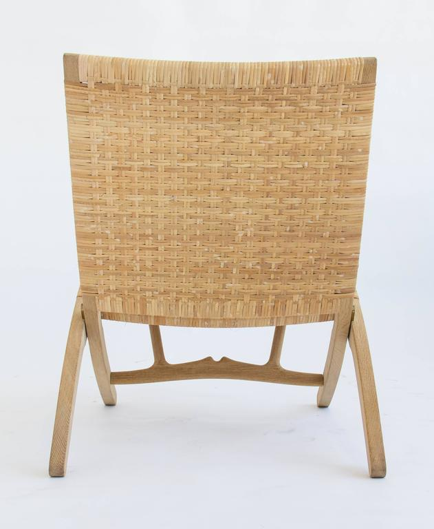 Pair of Hans Wegner Oak and Cane Folding Lounge Chairs  In Excellent Condition In Los Angeles, CA