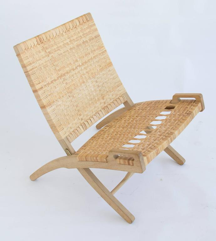 Mid-20th Century Pair of Hans Wegner Oak and Cane Folding Lounge Chairs