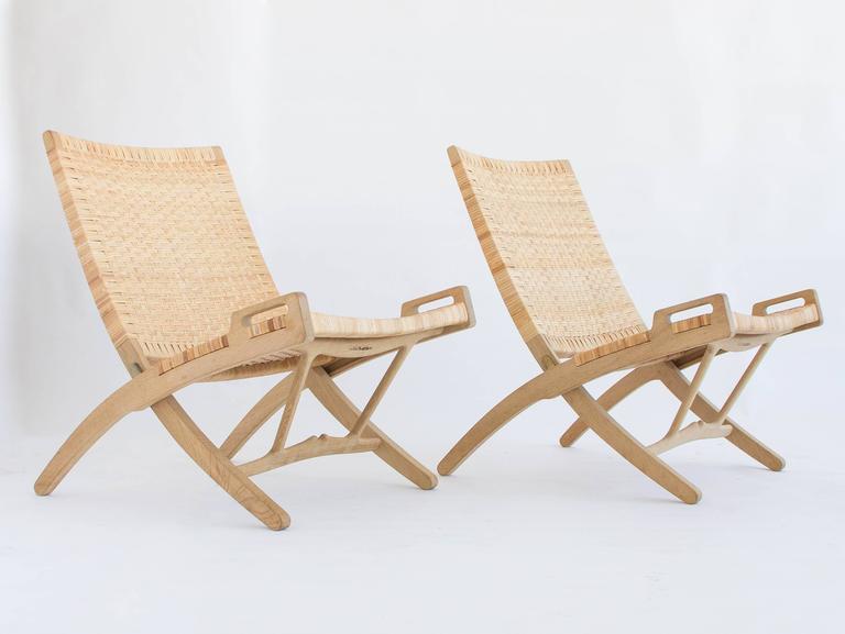 Scandinavian Modern Pair of Hans Wegner Oak and Cane Folding Lounge Chairs