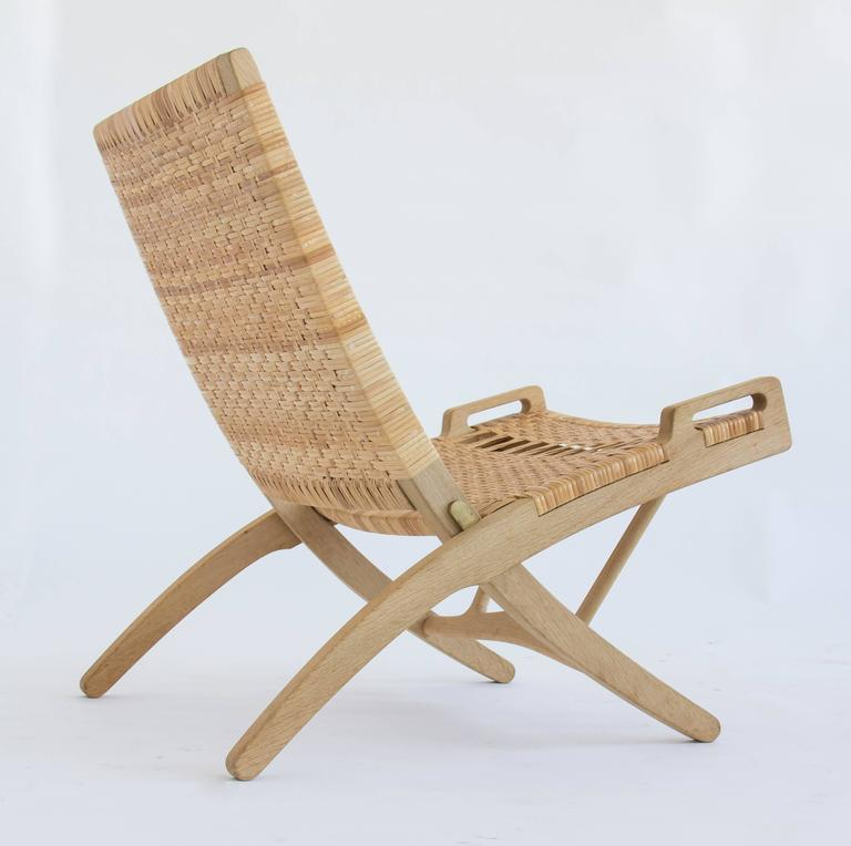Pair of Hans Wegner Oak and Cane Folding Lounge Chairs  1