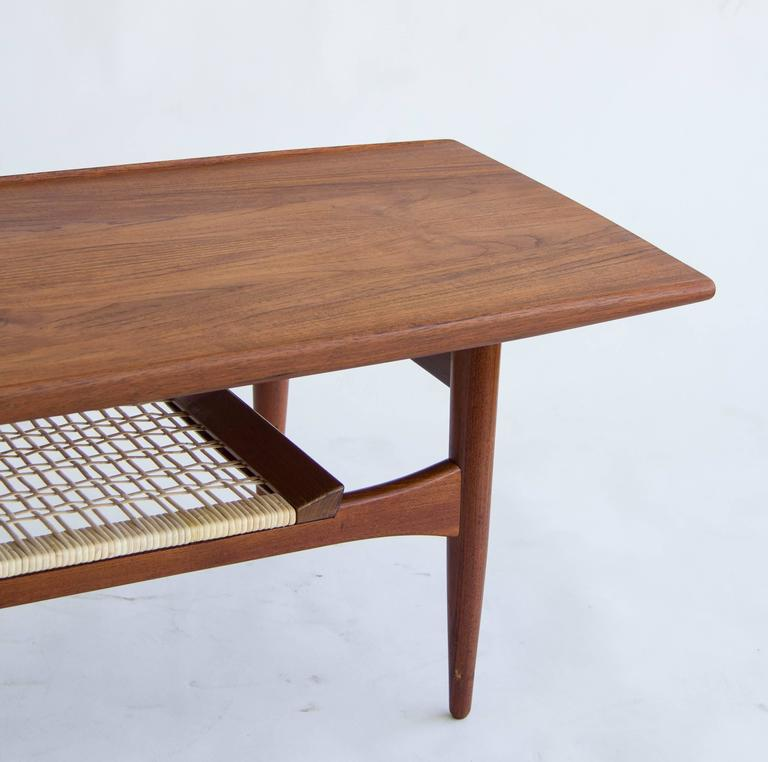 Danish Teak Coffee Table with Cane Shelf at 1stdibs
