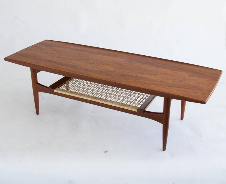 Danish Teak Coffee Table With Cane Shelf In Excellent Condition For Los Angeles