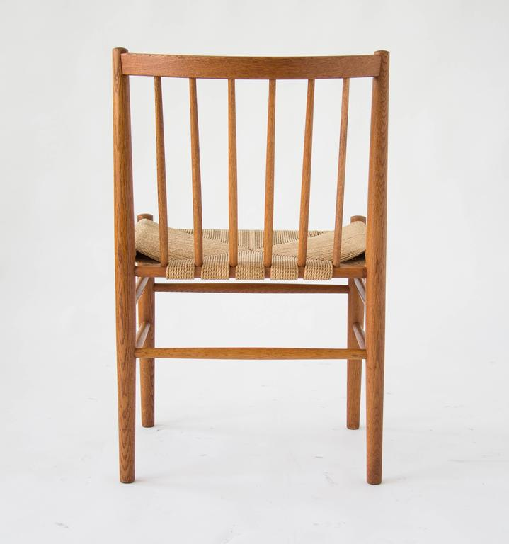 Oak Spindle Dining Chairs ~ Six spindle backed oak and danish cord dining chairs at
