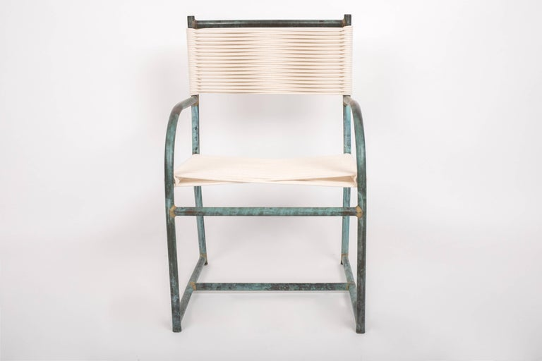 A set of six dining chairs by Walter Lamb dating from the late 1940s or early 1950s from the early years of his work with Brown Jordan. The chairs have a frame in tubular bronze with the verdigris patina characteristic to his work. The chair sits on