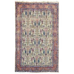Characterful Distressed Antique Tabriz Carpet with Stylized Cypress Trees