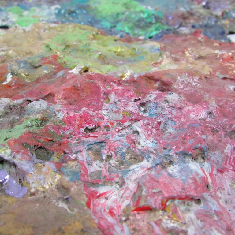 This is a beautifully vibrant artists paint palette once belonging to Seattle artist Joe Reno. Years of use create paint build-up with wonderful colors and texture. Signed on the back.